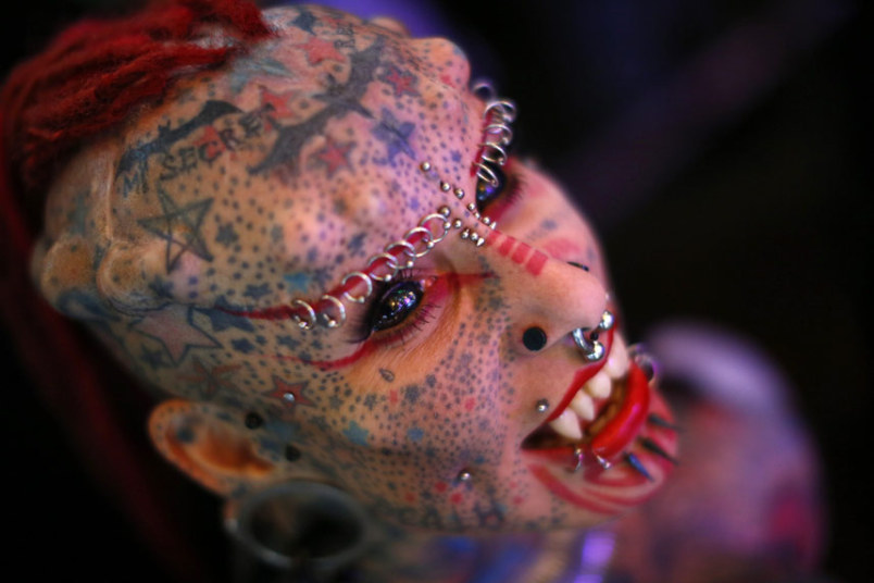 Psychopaths don't look dangerous. They blend in so they can take advantage of people's ignorance. Photo of extreme tattoos and piercings.